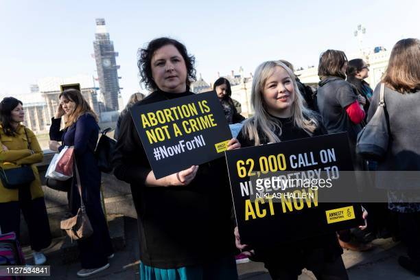 Derry Girls cast members Siobhan McSweeney and Nicola Coughlan hold placards as they take part in a protest calling for change to Northern Ireland's...