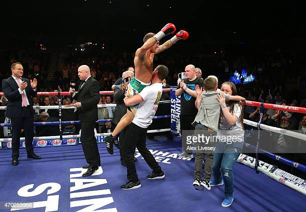 Derry Mathews celebrates with his trainers and family after victory over Tony Luis in The Vacant WBA Interim World Lightweight Championship fight...