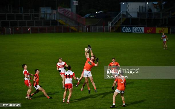 Derry , United Kingdom - 1 November 2020; Jarly Og Burns of Armagh in action against Conor Glass of Derry during the Ulster GAA Football Senior...