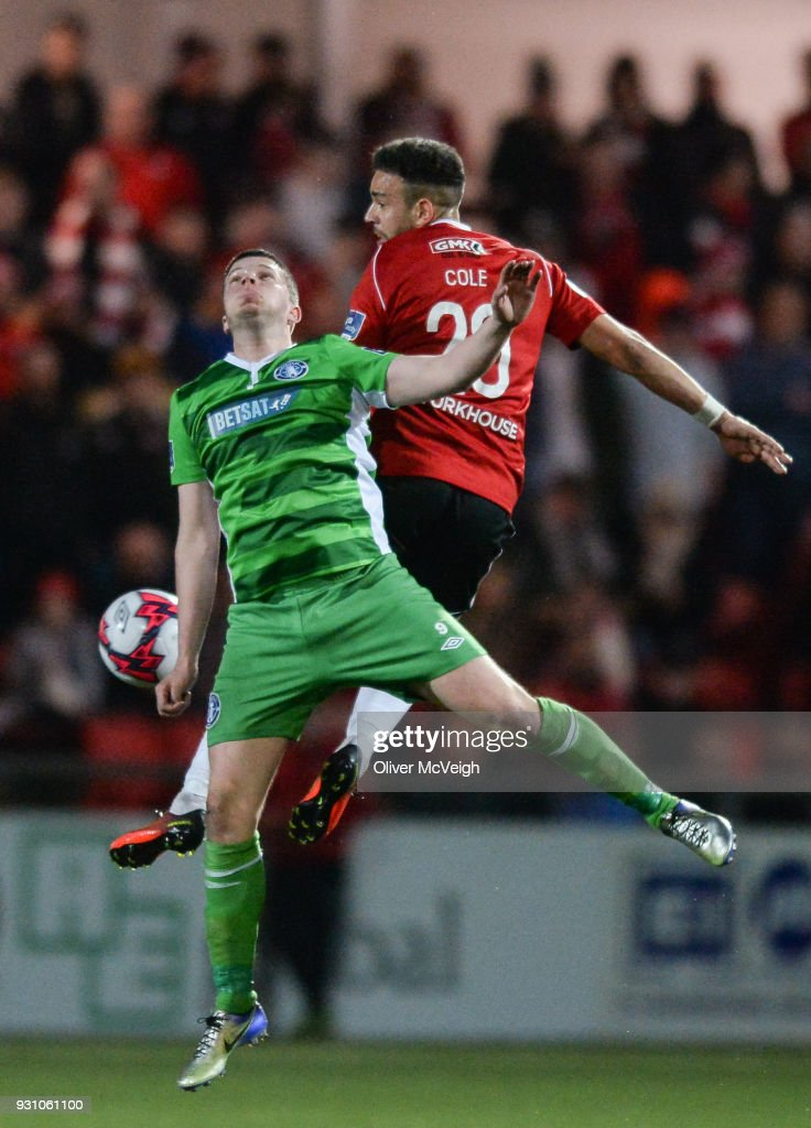 Derry , United Kingdom - 12 March 2018; Darren Cole of Derry City in action against Danny Morrissey of Limerick during the SSE Airtricity League Premier Division match between Derry City and Limerick at Brandywell Stadium in Derry.