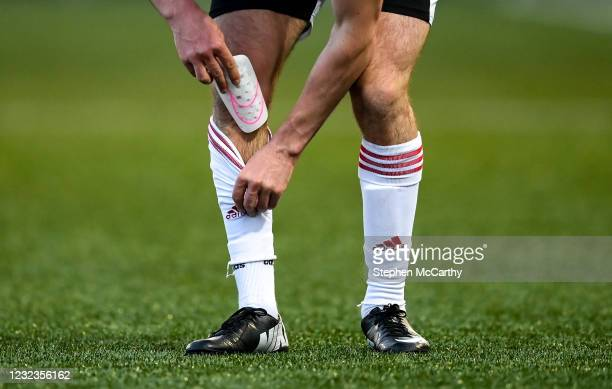 Derry , United Kingdom - 16 April 2021; A player puts a shin pad back into his sock during the SSE Airtricity League Premier Division match between...