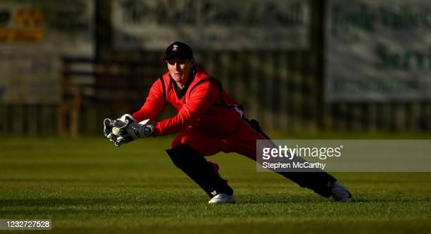 Derry , United Kingdom - 6 May 2021; Peter Moor of Munster Reds makes a catch during the Cricket Ireland InterProvincial Cup 2021 match between North...