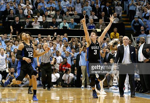 Derryck Thornton watches as teammate Grayson Allen of the Duke Blue Devils celebrates after defeating the North Carolina Tar Heels 7473 as head coach...