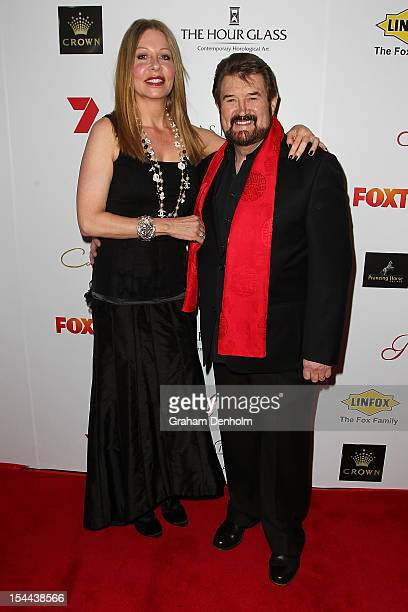 Derryn Hinch and wife Chanel Hinch arrive at the Fight Cancer Foundation's 20th Annual Red Ball on October 20 2012 in Melbourne Australia