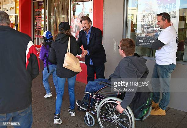 Derryn Hinch of Derryn Hinch's Justice Party greets supporters as he campaigns in Drouin on June 3 2016 in Melbourne Australia The broadcaster turned...