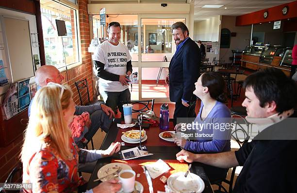 Derryn Hinch of Derryn Hinch's Justice Party hands out flyers and meets supporters in a cafe as he campaigns in Korumburra on June 3 2016 in...