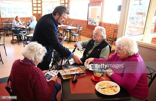 Derryn Hinch of Derryn Hinch's Justice Party hands out flyers in a cafe as he campaigns in Korumburra on June 3 2016 in Melbourne Australia The...