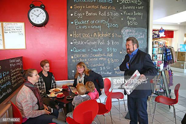 Derryn Hinch of Derryn Hinch's Justice Party hands out flyers to people eating in a cafe as he campaigns in Pakenham on June 3 2016 in Melbourne...