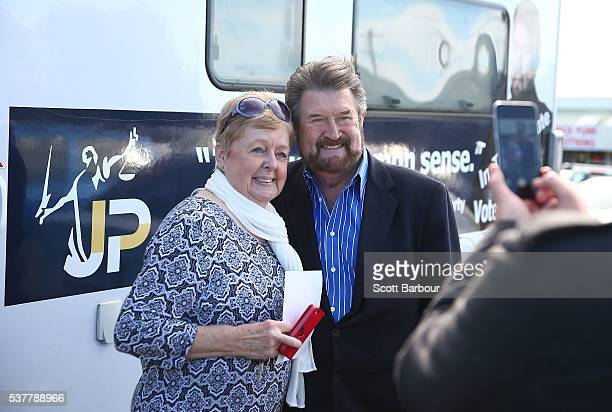 Derryn Hinch of Derryn Hinch's Justice Party has his photo taken with a supporter as he stops in Pakenham on June 3 2016 in Melbourne Australia The...