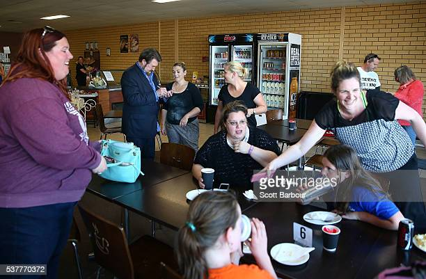 Derryn Hinch of Derryn Hinch's Justice Party signs an autograph for a supporter after meeting people in a cafe as he campaigns in Lang Lang on June 3...