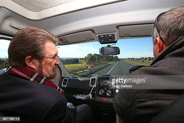 Derryn Hinch of Derryn Hinch's Justice Party talks with his running mate Stuart Grimley in his campaign Winnebago on June 3 2016 in Melbourne...