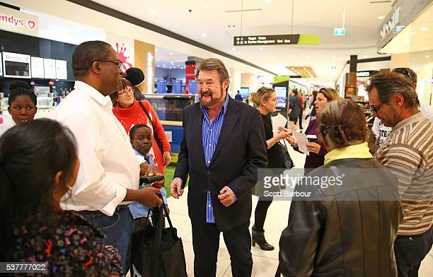 Derryn Hinch of Derryn Hinch's Justice Party talks with supporters as he visits Cranbourne on June 3 2016 in Melbourne Australia The broadcaster...