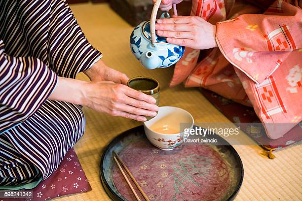 dertail of having traditional japanese tea in kyoto japan - kyoto prefecture stock pictures, royalty-free photos & images