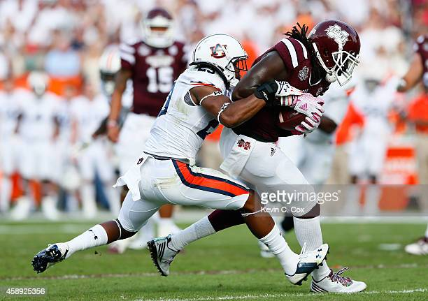 De'Runnya Wilson of the Mississippi State Bulldogs against Johnathan Ford of the Auburn Tigers at Davis Wade Stadium on October 11 2014 in Starkville...
