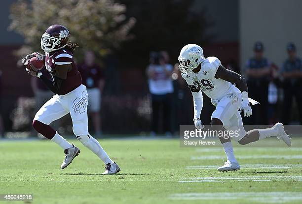 De'Runnya Wilson of the Mississippi State Bulldogs catches a pass in front of Deshazor Everett of the Texas AM Aggies during the second quarter of a...
