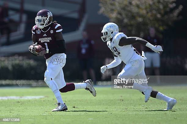 De'Runnya Wilson of the Mississippi State Bulldogs catches a pass in front of Deshazor Everett of the Texas AM Aggies during the first quarter of a...