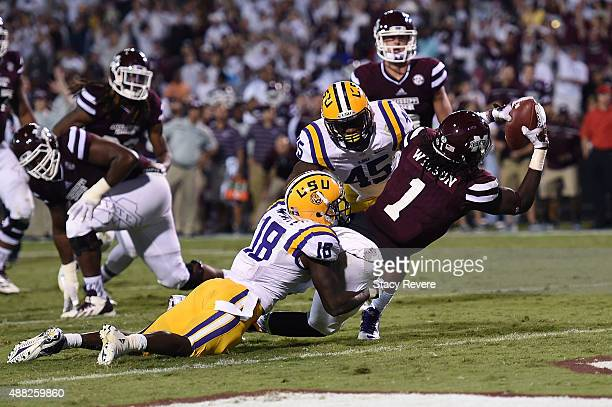 De'Runnya Wilson of the Mississippi State Bulldogs catches a pass in front of Tre'Davious White of the LSU Tigers for a touchdown during a game at...