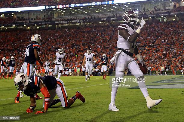 De'Runnya Wilson of the Mississippi State Bulldogs celebrates a touchdown catch during the first half against the Auburn Tigers at Jordan Hare...
