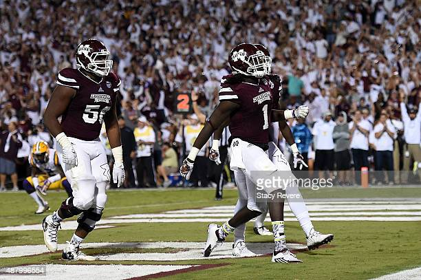 De'Runnya Wilson of the Mississippi State Bulldogs celebrates a touchdown against the LSU Tigers during the fourth quarter of a game at Davis Wade...
