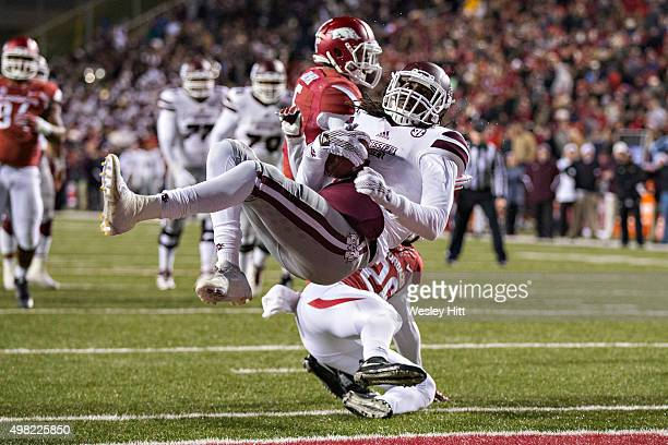 DeRunnya Wilson of the Mississippi State Bulldogs dives into the end zone over Rohan Gaines of the Arkansas Razorbacks at Razorback Stadium Stadium...