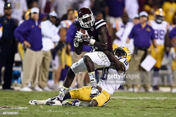 De'Runnya Wilson of the Mississippi State Bulldogs is brought down by Tre'Davious White of the LSU Tigers during the fourth quarter of a game at...