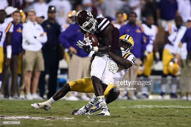 De'Runnya Wilson of the Mississippi State Bulldogs is brought down by Tre'Davious White of the LSU Tigers during a game at Davis Wade Stadium on...