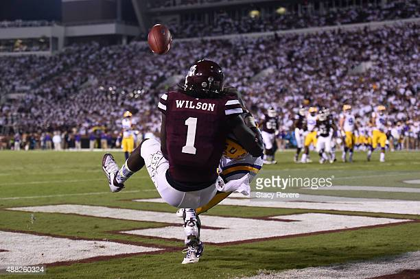 De'Runnya Wilson of the Mississippi State Bulldogs is defended by Tre'Davious White of the LSU Tigers during a game at Davis Wade Stadium on...