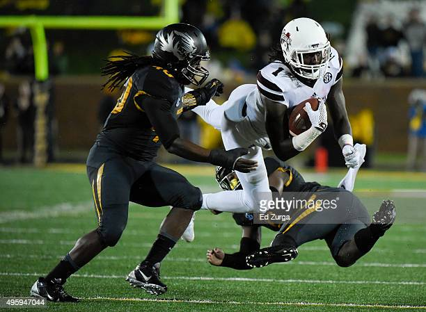 De'Runnya Wilson of the Mississippi State Bulldogs is stopped short of a first down by Thomas Wilson and Clarence Green of the Missouri Tigers in the...