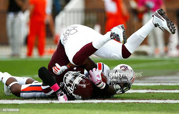 De'Runnya Wilson of the Mississippi State Bulldogs is tackled as he scores a touchdown against Jonathan Jones of the Auburn Tigers at Davis Wade...