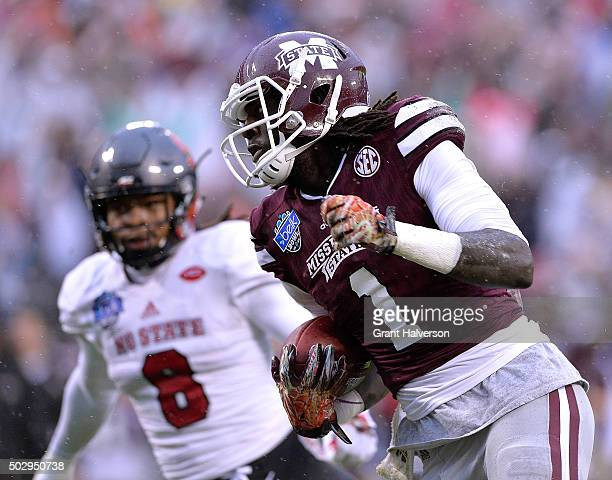 De'Runnya Wilson of the Mississippi State Bulldogs makes a touchdown catch against Dravious Wright of the North Carolina State Wolfpack during the...