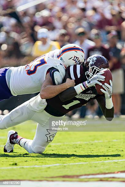 De'Runnya Wilson of the Mississippi State Bulldogs reaches out for a touchdown but his knee hits down at the one while being tackled by Peyton Guidry...