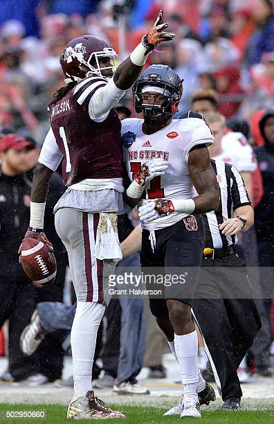 De'Runnya Wilson of the Mississippi State Bulldogs signals for a first down after making a catch against Juston Burris of the North Carolina State...
