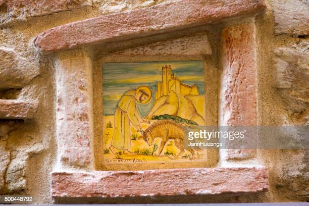 deruta, umbria old town: st francis ceramic tile on old wall - st. francis of assisi stock photos and pictures