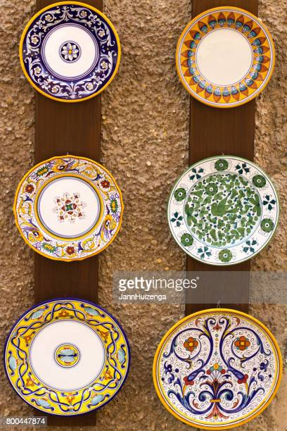 deruta, umbria old town: sunlit majolica displayed outside shop - ceramic stock photos and pictures