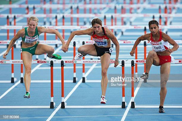 Derval O'Rourke of Ireland Carolin Nytra of Germany and Nevin Yanit of Turkey compete in the Womens 100m Hurdles Semi Final during day five of the...