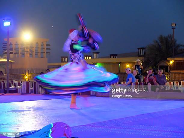 Dervish dancer in a Bedouin desert camp in Dubai United Arabian Emirates