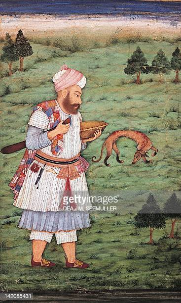 Dervish with his dog holding a box for alms in his hand miniature from the Mughal School ca 1630 India 18th Century