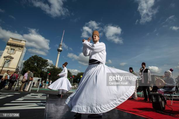 Dervishes perform a traditional dance on the event at 'About Berlin religions make history' of historical significance as the broadcast tower at...