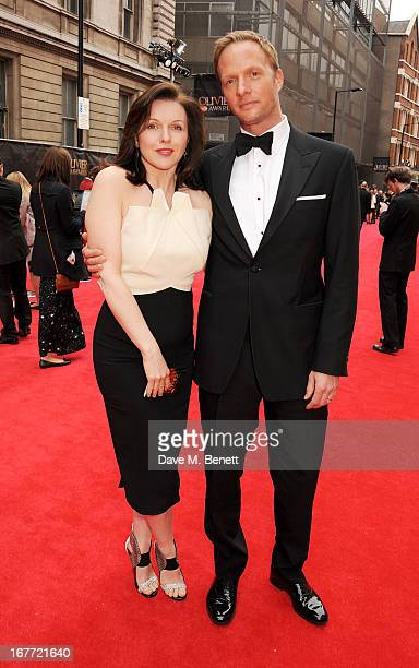 Dervla Kirwan and Rupert Penry Jones arrive at The Laurence Olivier Awards 2013 at The Royal Opera House on April 28 2013 in London England