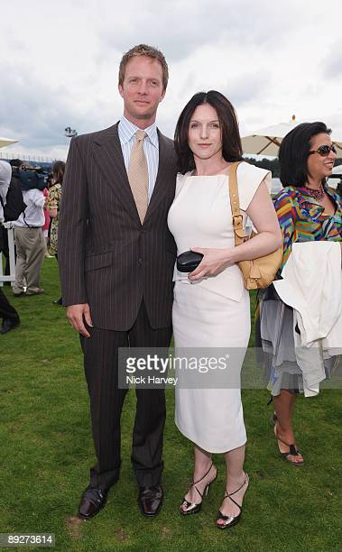 Dervla Kirwan and Rupert PenryJones at the Cartier tent during the Cartier Internaional Polo Day at Guards Polo Club on July 26 2009 in Egham England