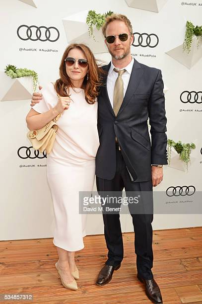 Dervla Kirwan and Rupert PenryJones attend day one of the Audi Polo Challenge at Coworth Park on May 28 2016 in London England