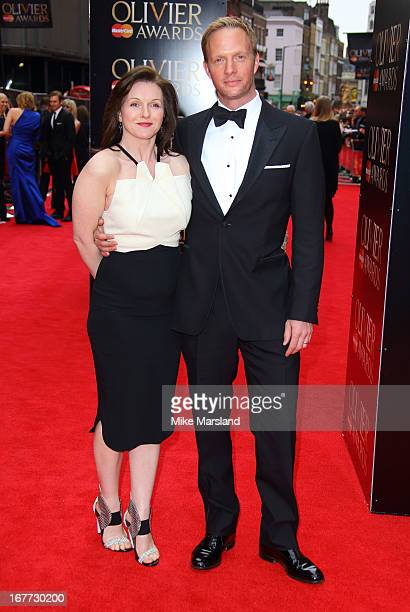 Dervla Kirwan and Rupert PenryJones attend The Laurence Olivier Awards at The Royal Opera House on April 28 2013 in London England