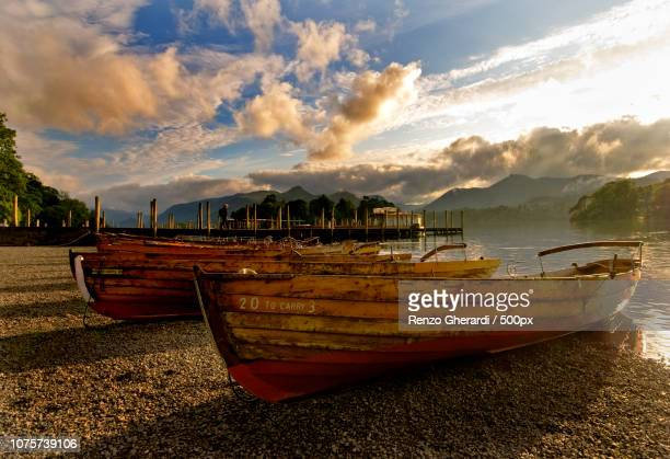 derwent water boats at sunset - renzo gherardi stock photos and pictures