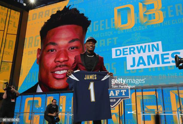 Derwin James of FSU poses after being picked overall by the Los Angeles Chargers during the first round of the 2018 NFL Draft at AT&T Stadium on...