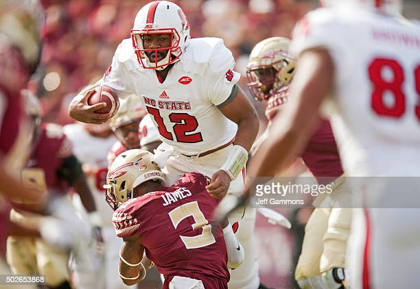 Derwin James of the Florida State Seminoles attampts to take down Jacoby Brissett of the North Carolina State Wolfpack during the game at Doak...