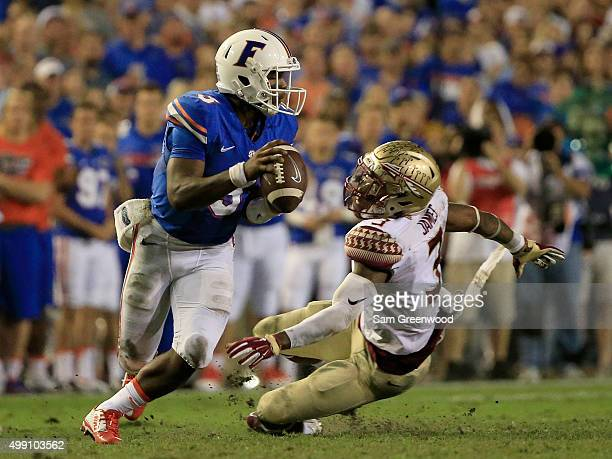 Derwin James of the Florida State Seminoles pressures Treon Harris of the Florida Gators during the game at Ben Hill Griffin Stadium on November 28...