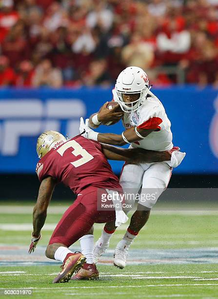 Derwin James of the Florida State Seminoles sacks quarterback Greg Ward Jr #1 of the Houston Cougars in the third quarter during the ChickfilA Peach...