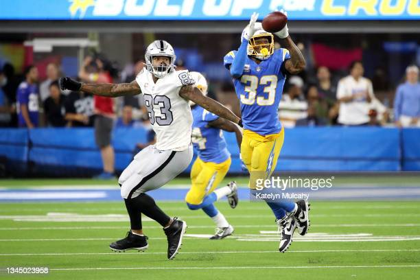 Derwin James of the Los Angeles Chargers intercepts a pass intended for Darren Waller of the Las Vegas Raiders during the fourth quarter at SoFi...