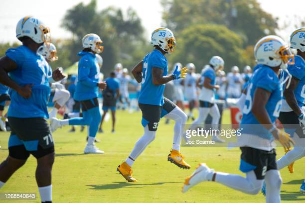 Derwin James of the Los Angeles Chargers warms up with the team during Los Angeles Chargers Training Camp at the Jack Hammett Sports Complex on...