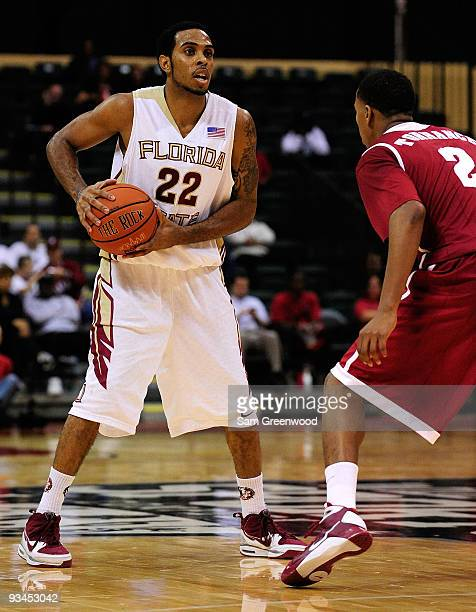 Derwin Kitchen of the Florida State Seminoles looks to pass against MikhailTorrance of the Alabama Crimson Tide during the Old Spice Classic at...